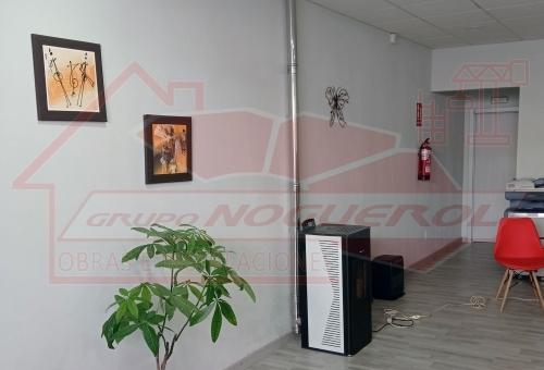 Instalación estufa de pellets para oficina en Melide